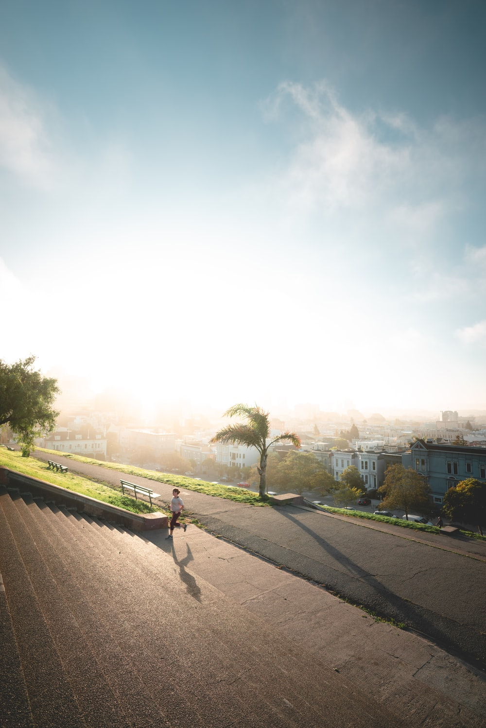 person running towards stairs during sunrise