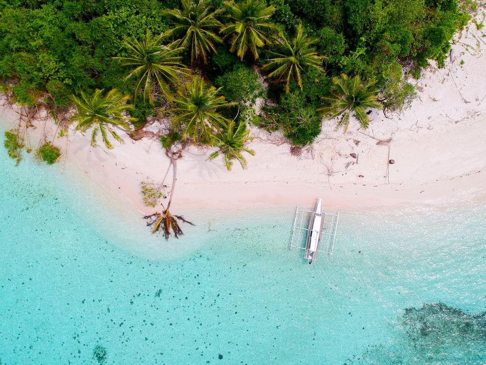 bird's-eye photography of boat on island