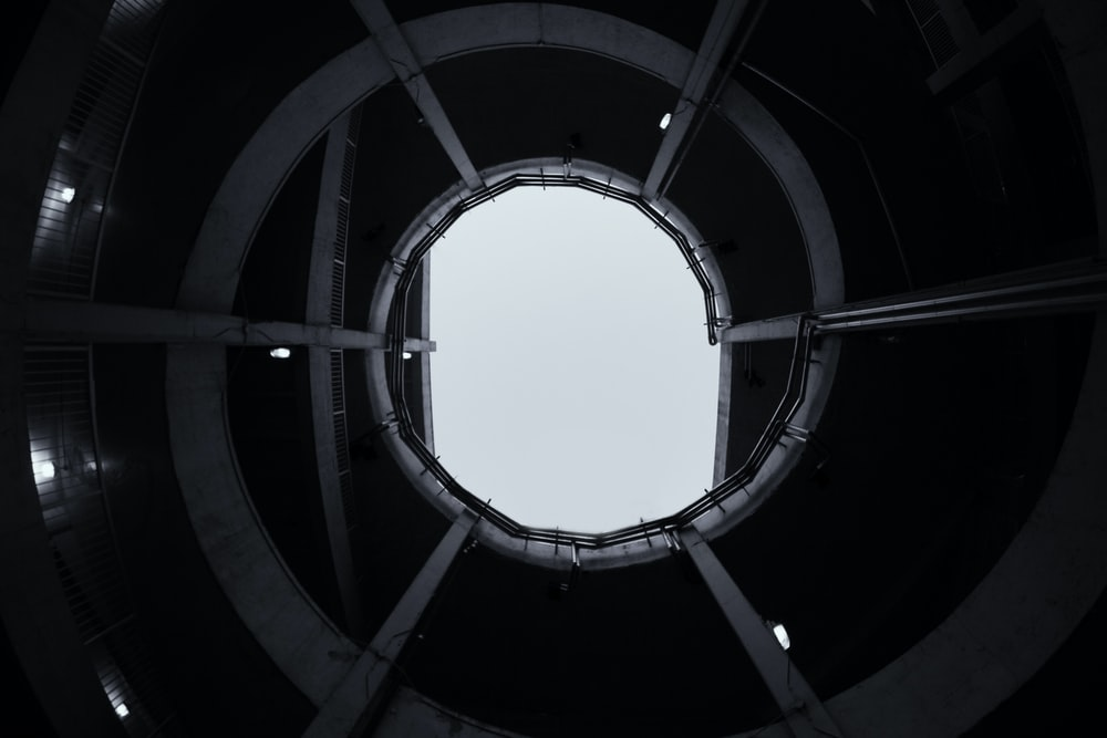 grayscale photo of spiral building