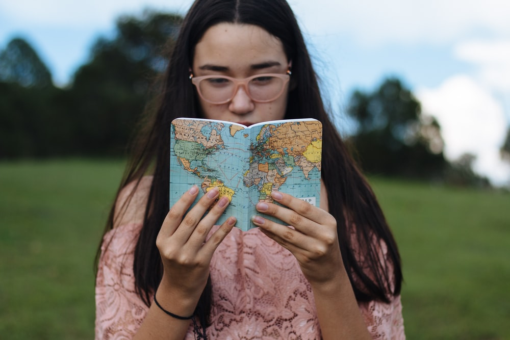 woman holding political map