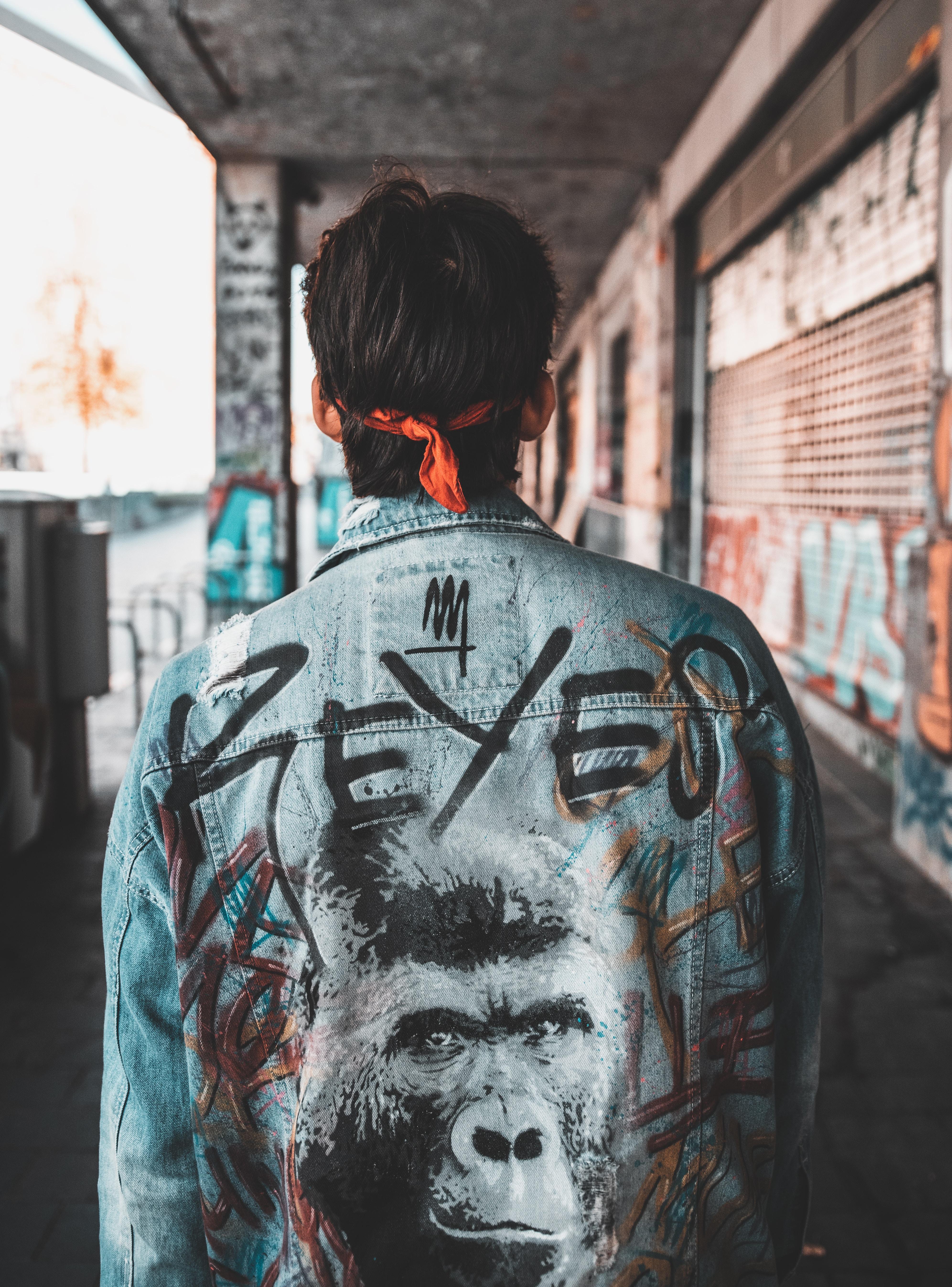 man wearing teal denim jacket