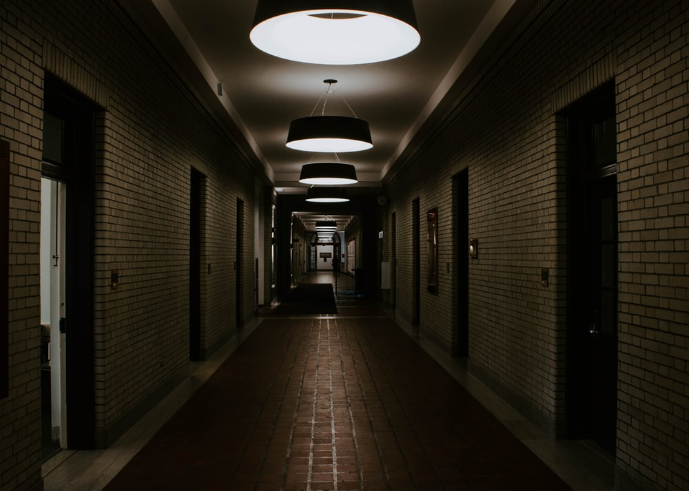 empty and lighted hallway of building