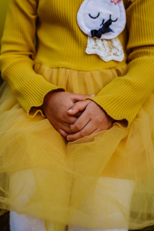 child wearing yellow long-sleeved dress
