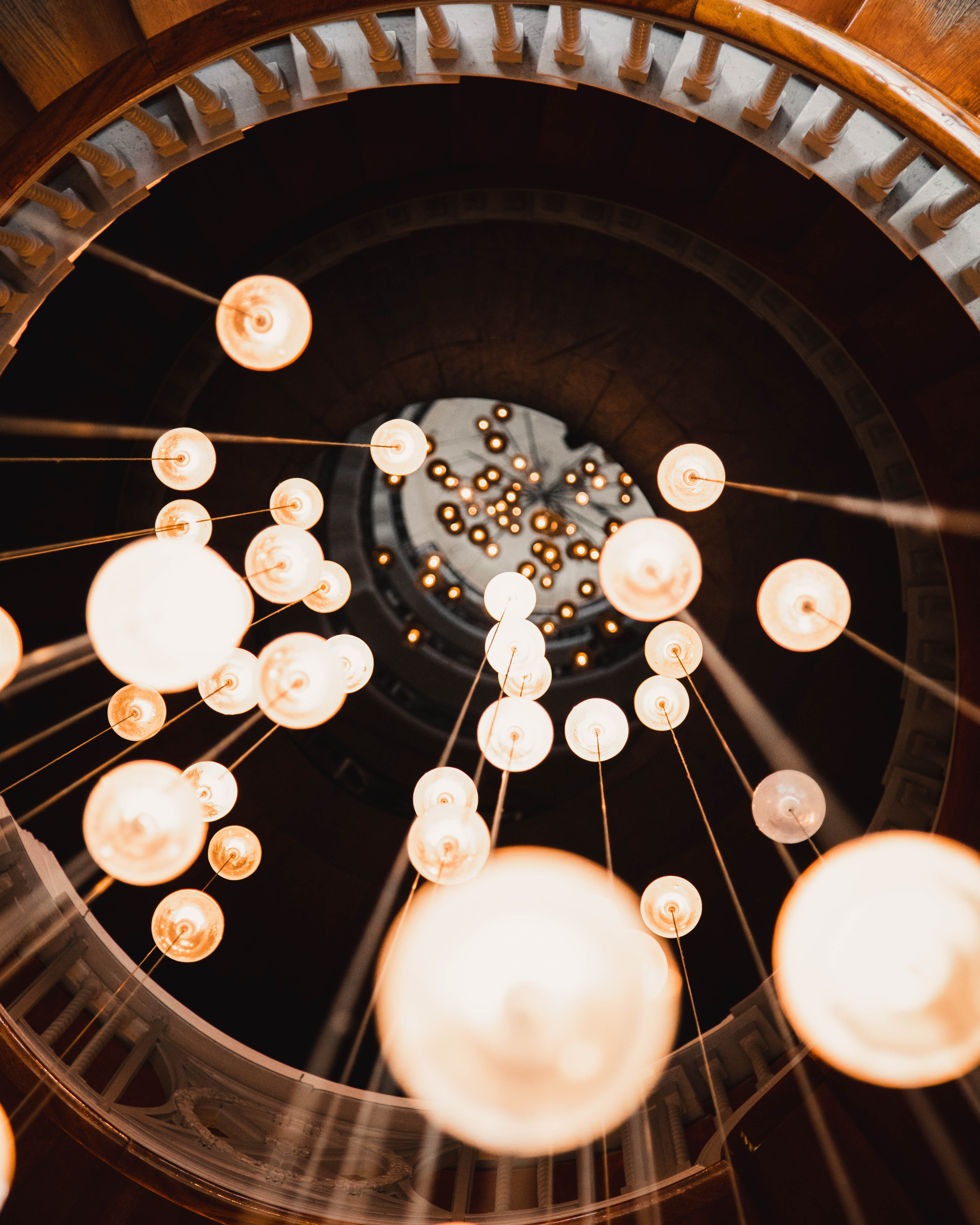 low-angle photography of lighted chandeliers