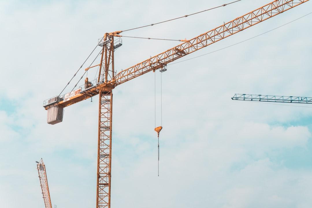 3 cranes in the sky