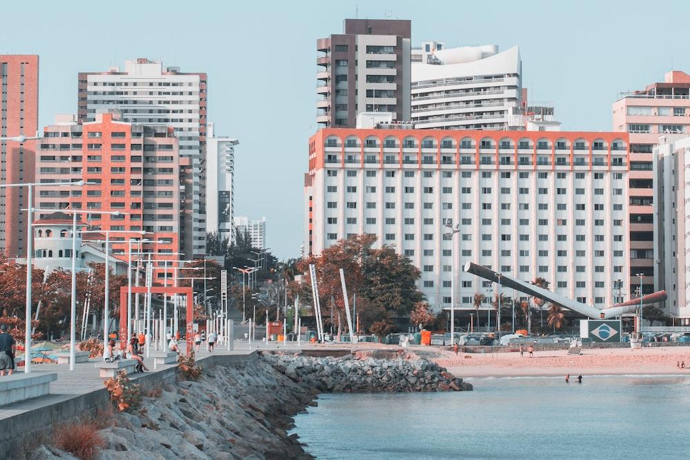 concrete building beside ocean during daytime