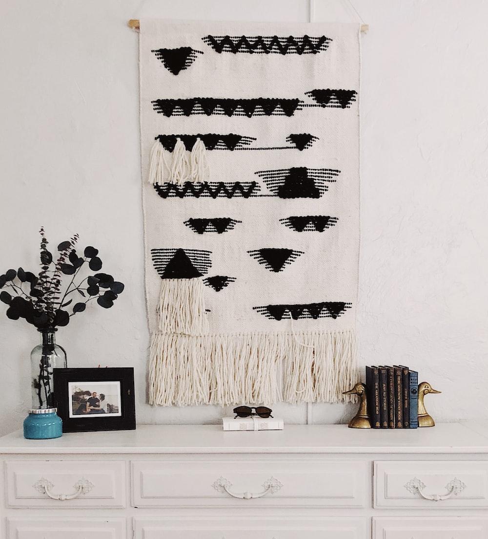 white and black string tapestry
