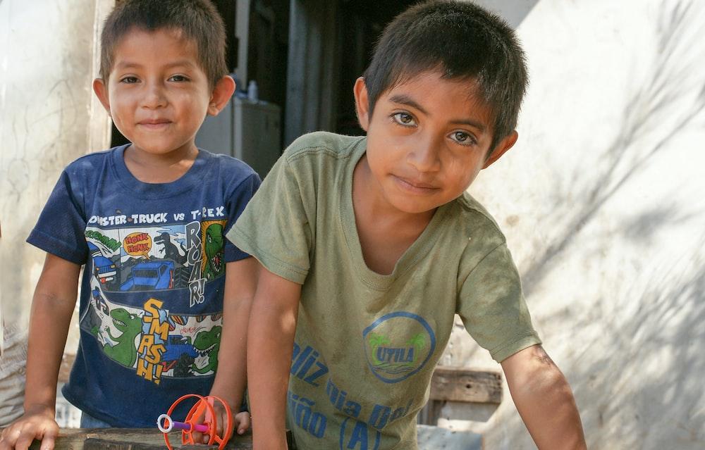 two boy smiling during daytime