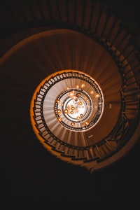 low-angle photography of stairs and pendant lamps
