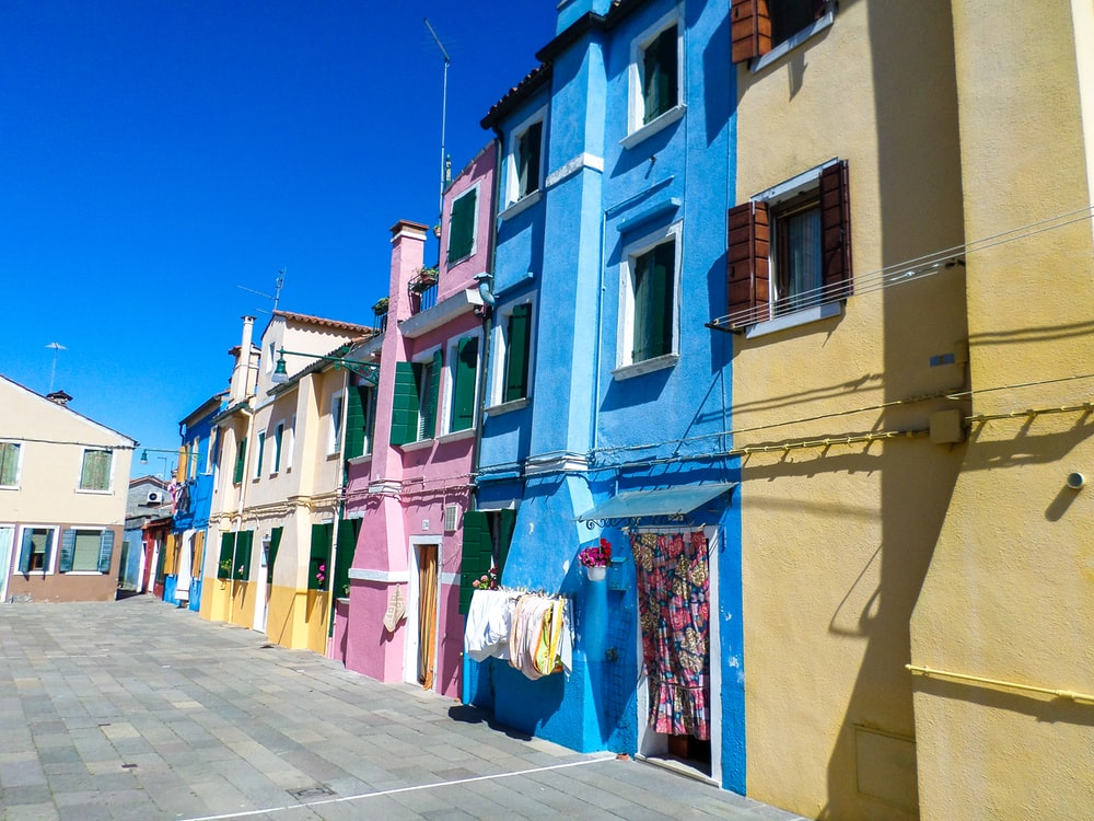 assorted-color houses under blue sky