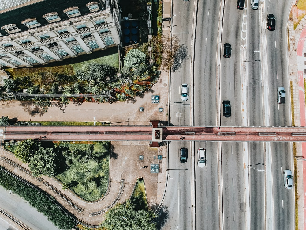 top view of road with moving vehicles