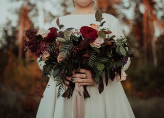 woman holding rose flowers