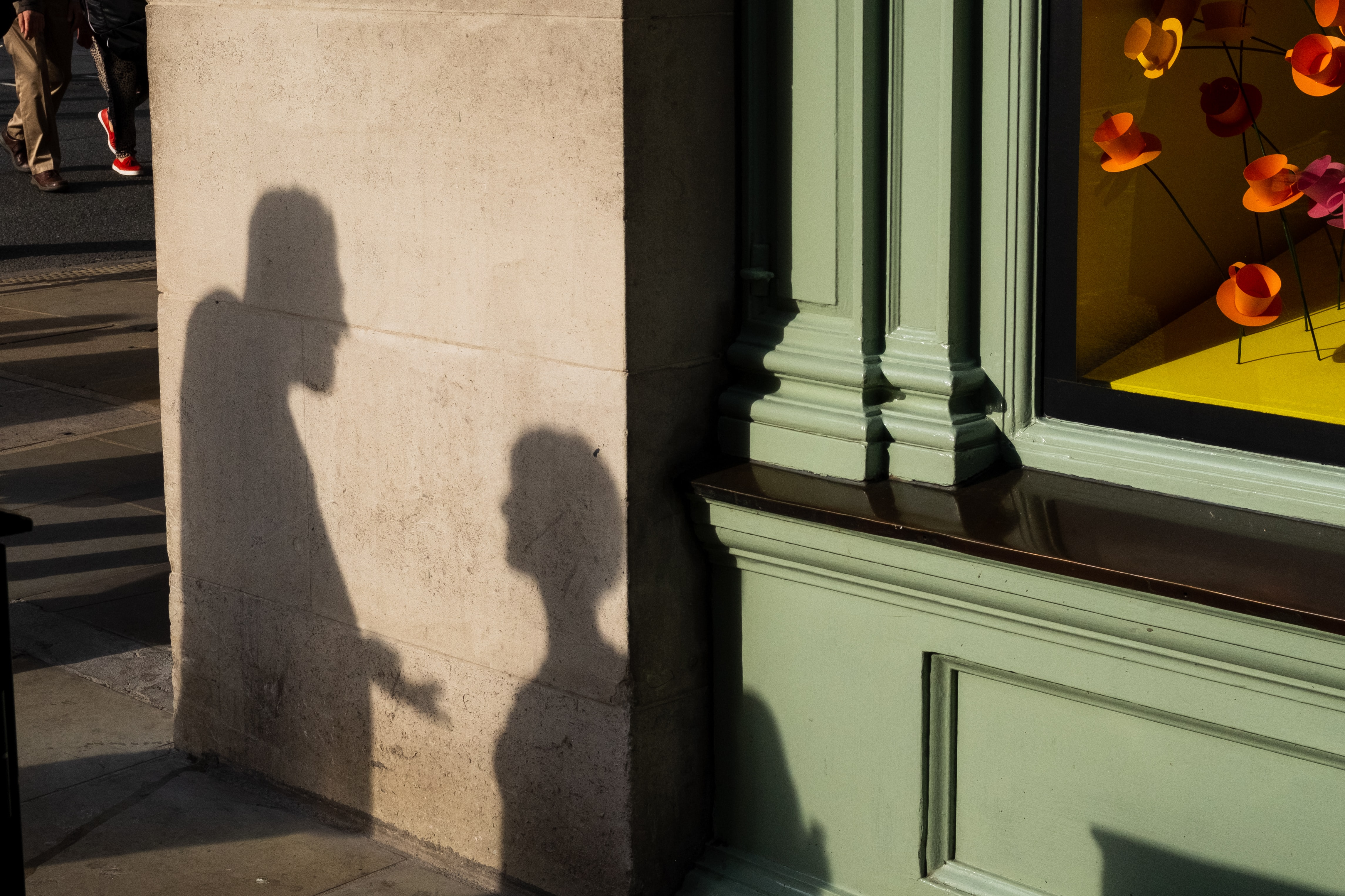shadows of people reflecting on wall