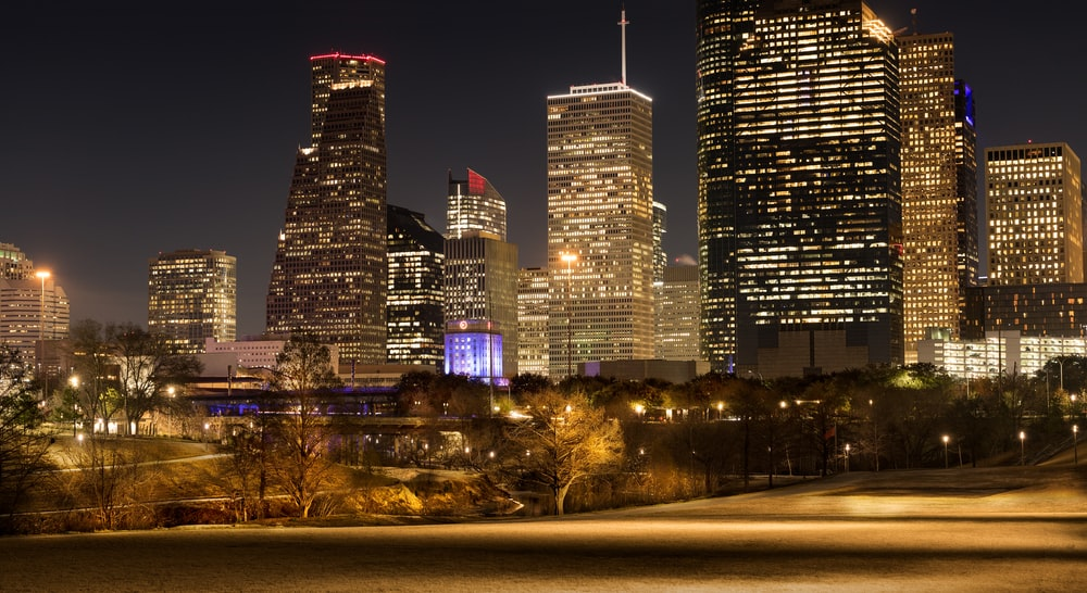 photo of lighted high raise buildings