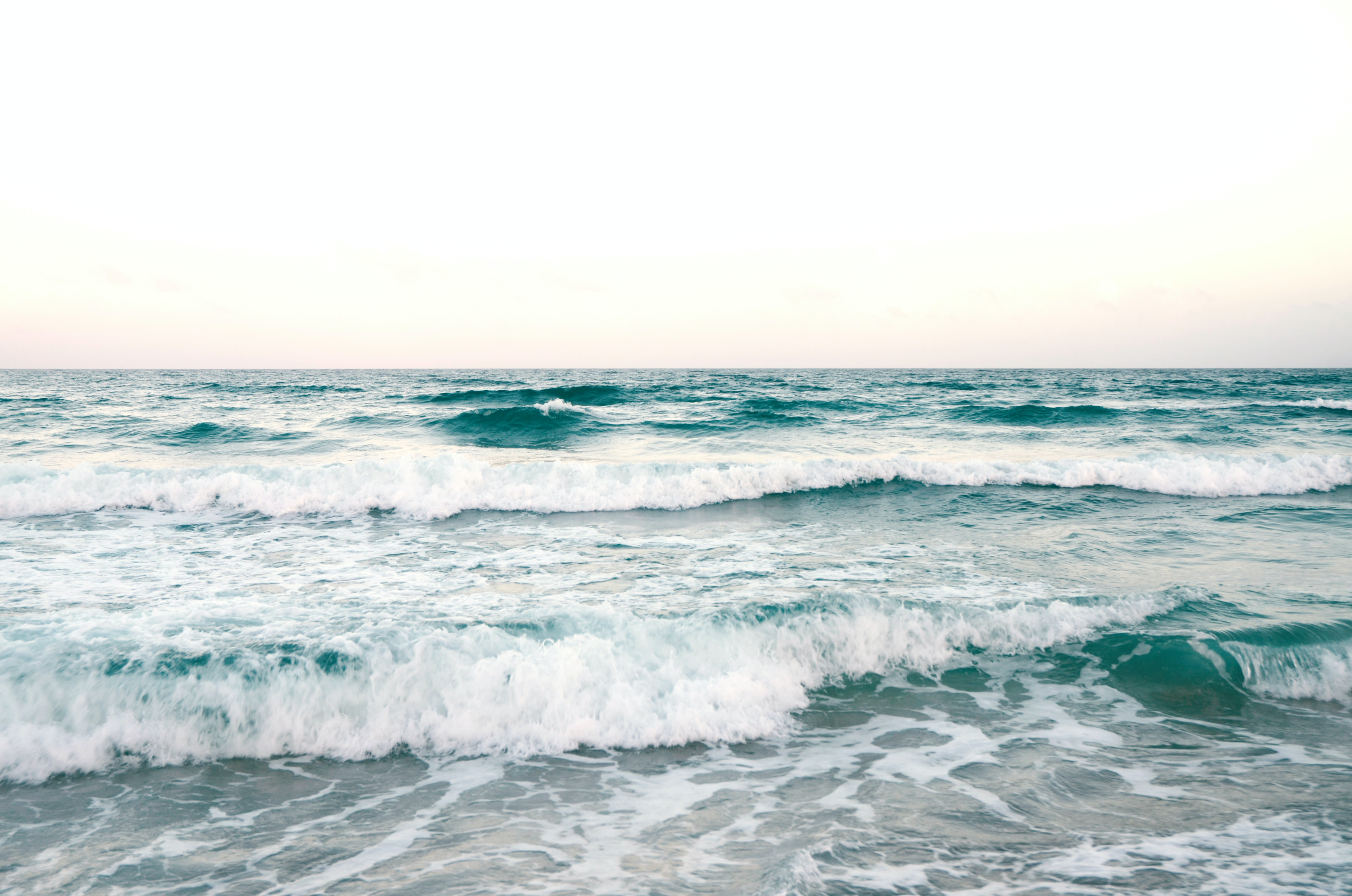 sea waves under clear sky during daytime