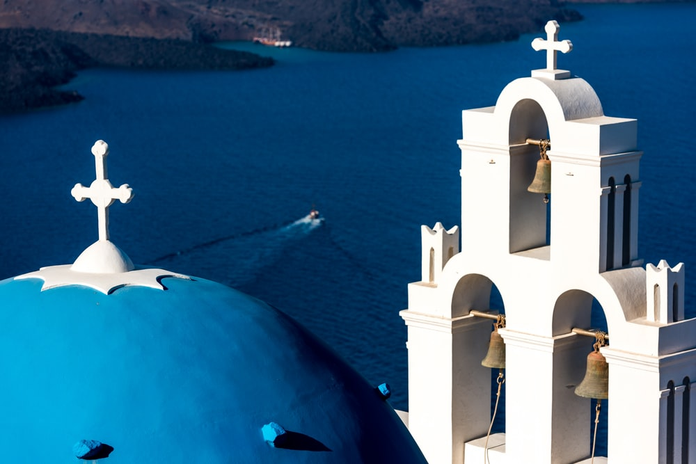 white cathedral and boat on seat