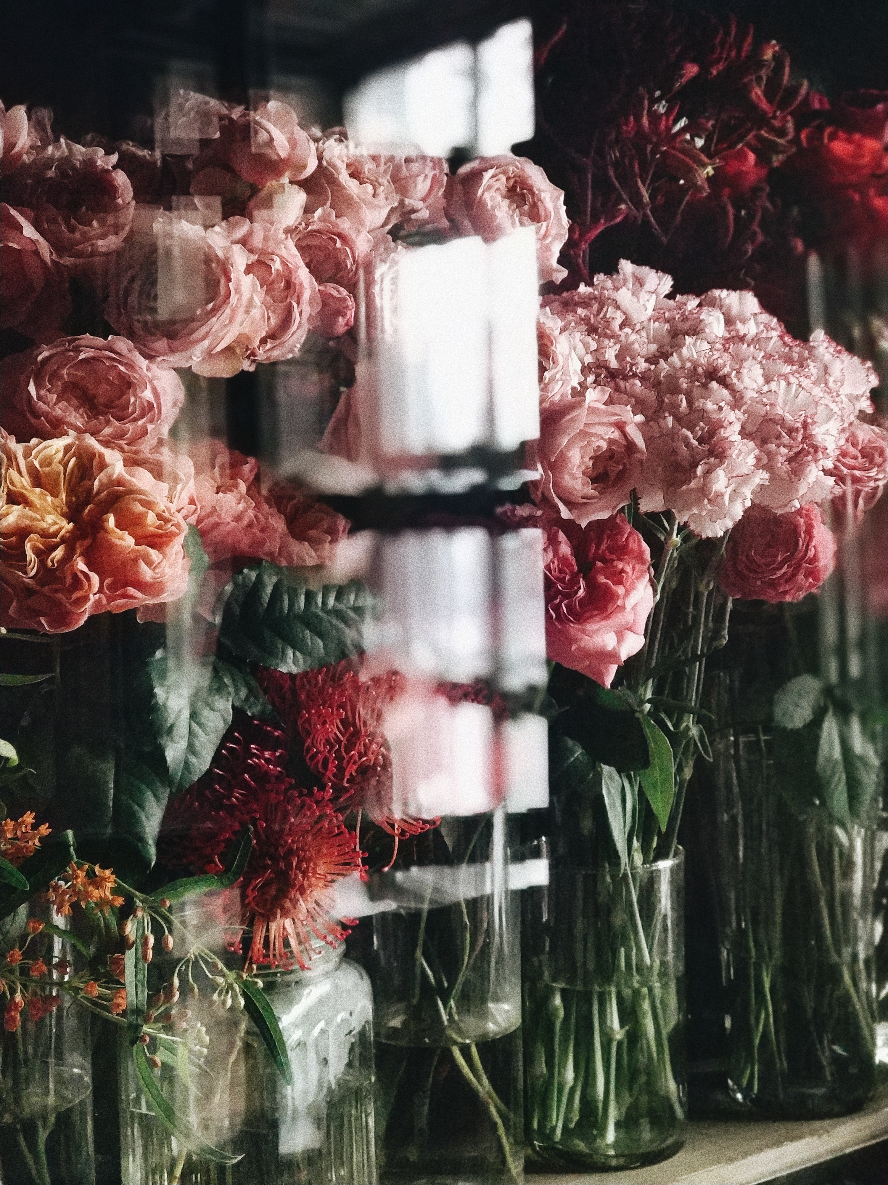 pink and red flowers in display cabinet
