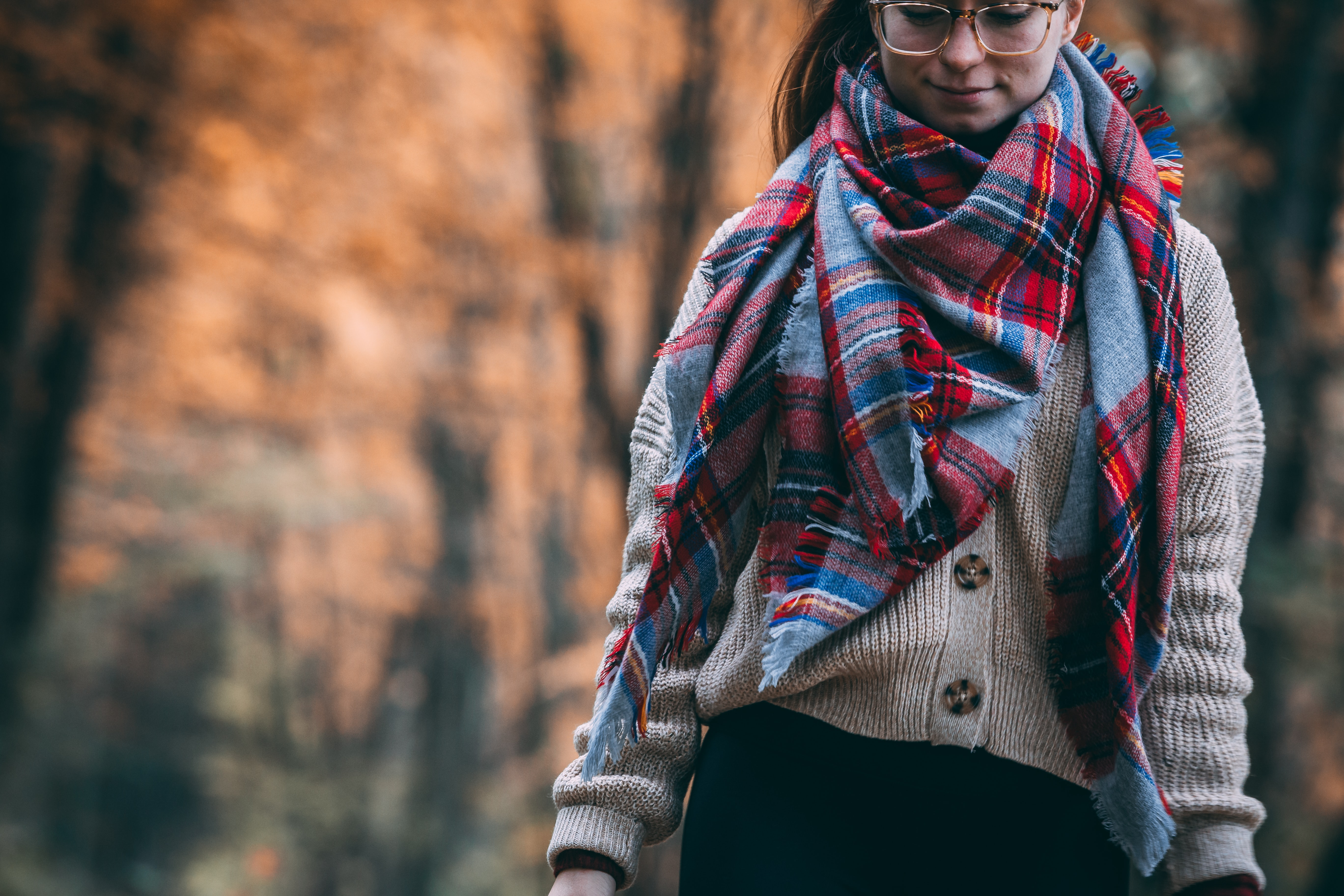 woman wearing gray cardigan and plaid scarf