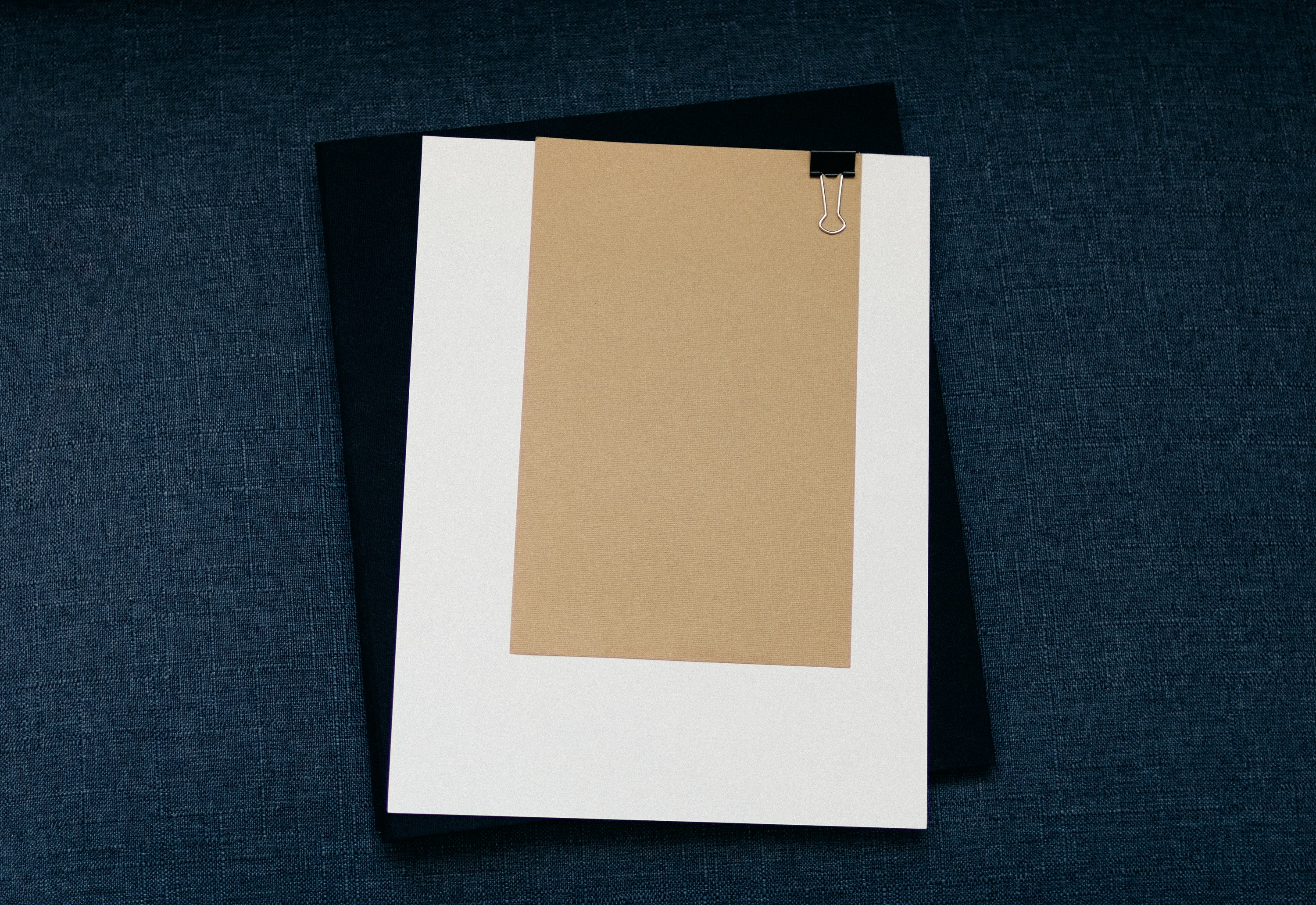 white clip board on black surface
