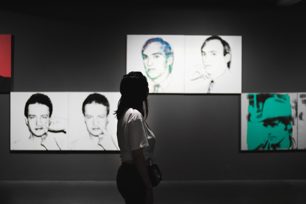woman wearing shirt while watching photo