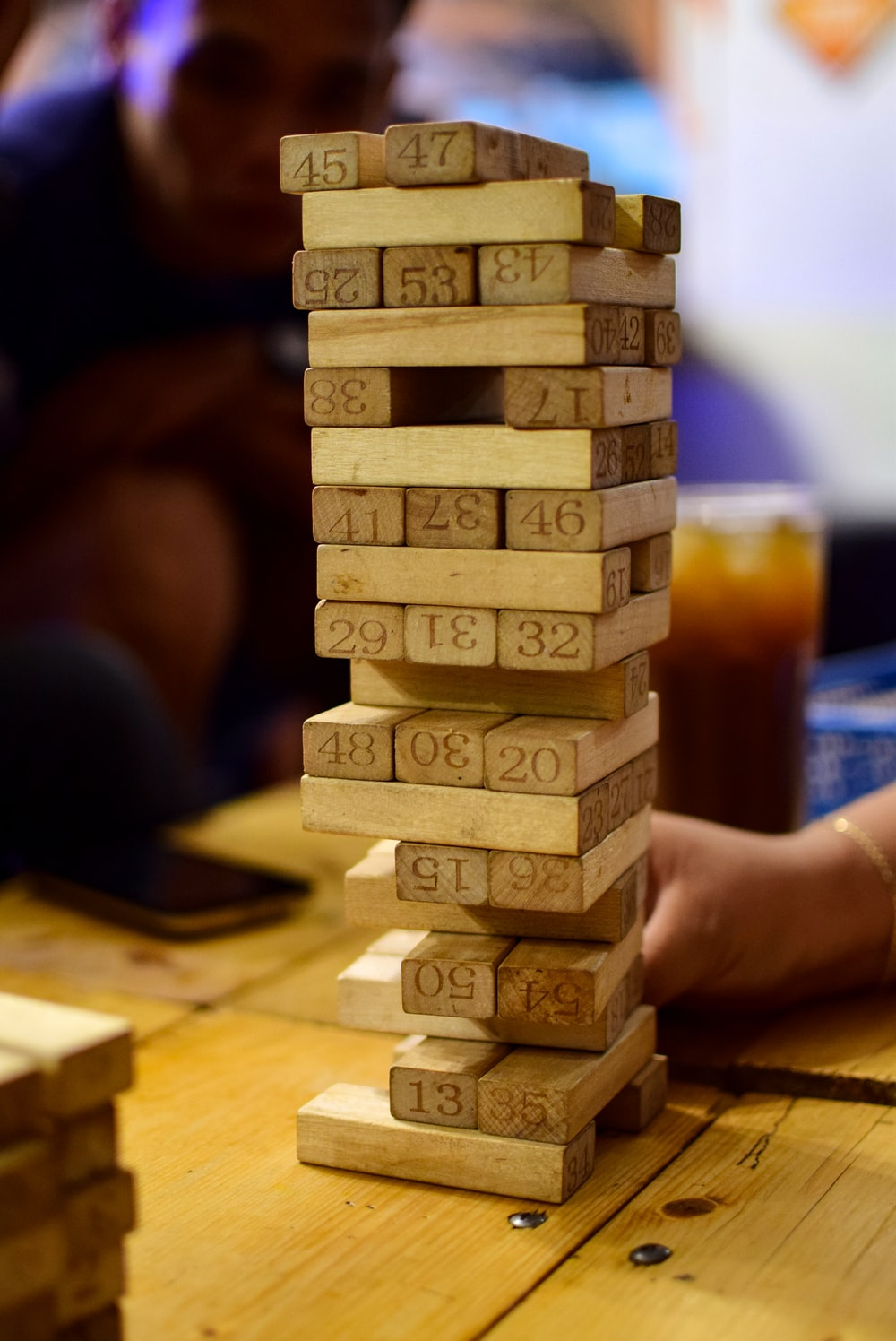 persons playing brown wooden blocks