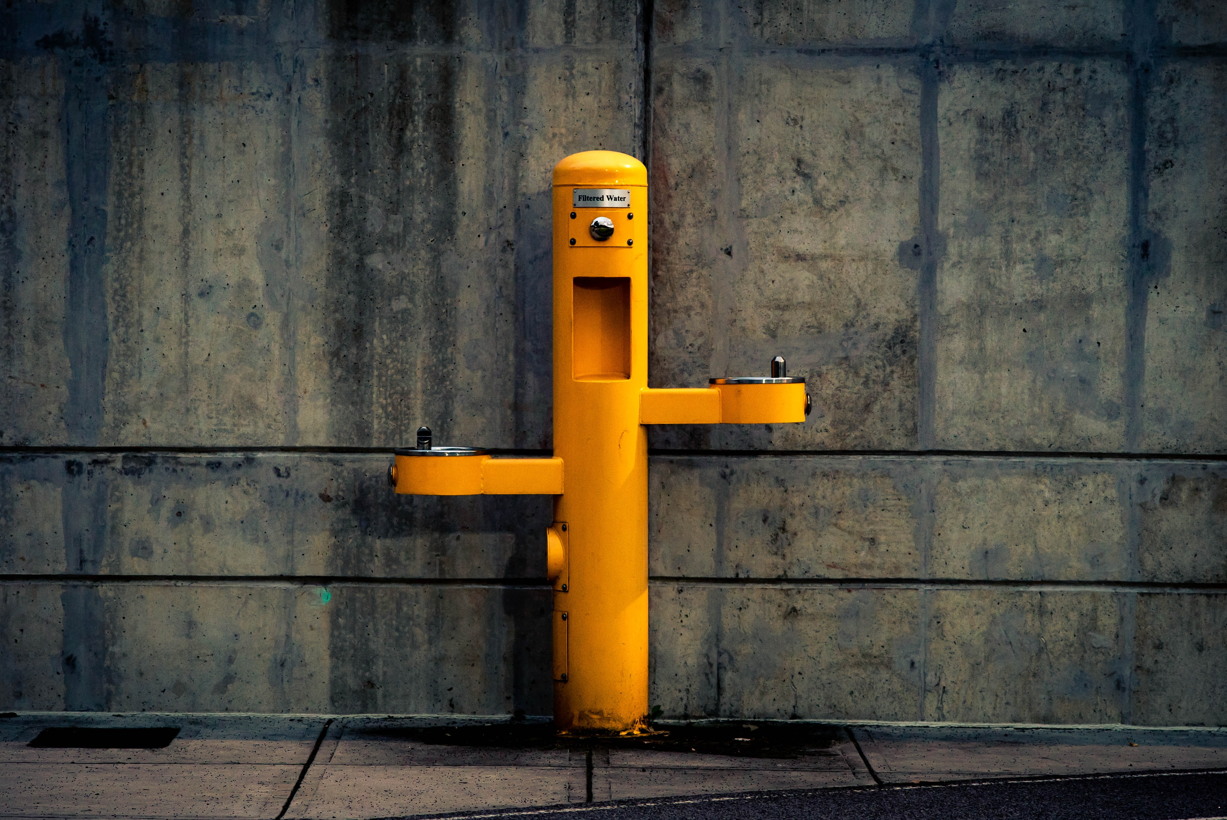 yellow pedestal outdoor post against wall