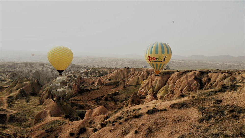 two yellow hot air balloons
