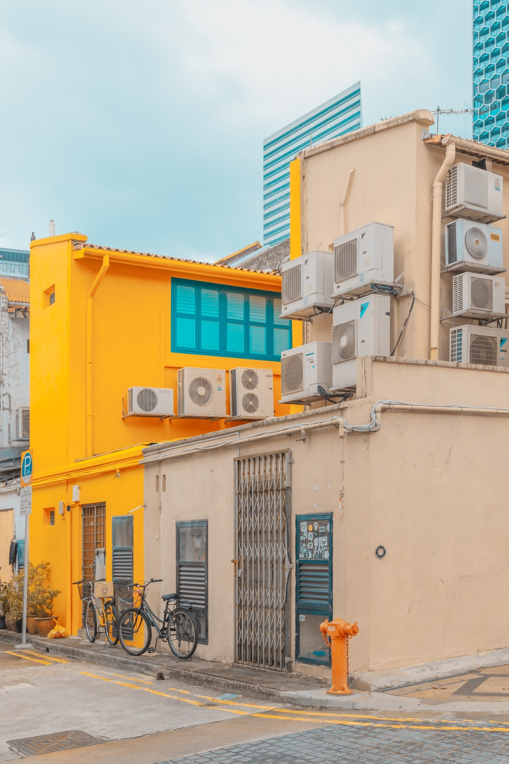 beige and yellow concrete house