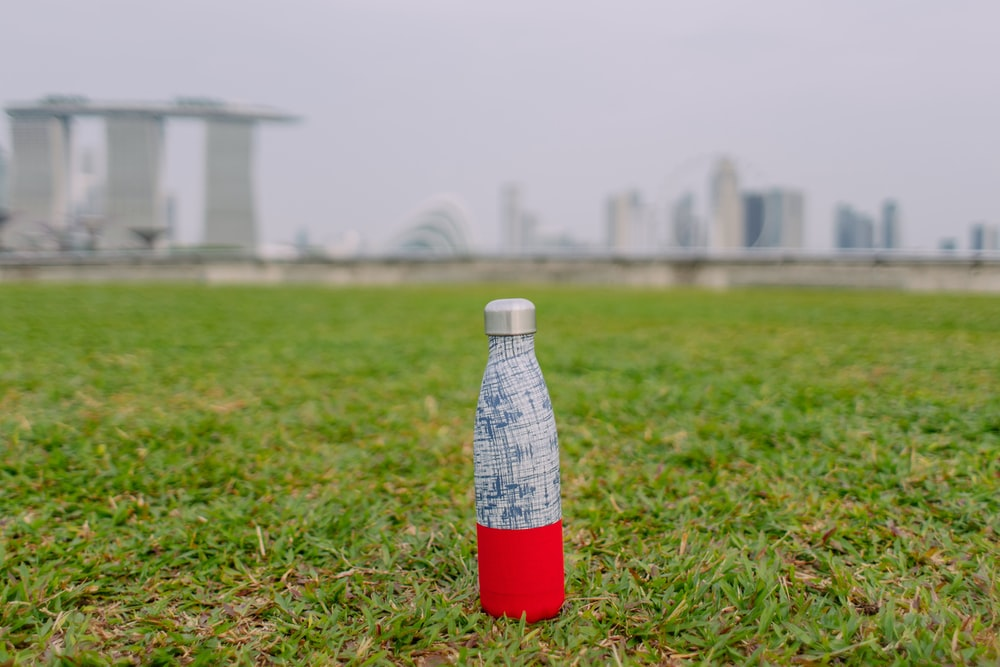 gray and red bottle