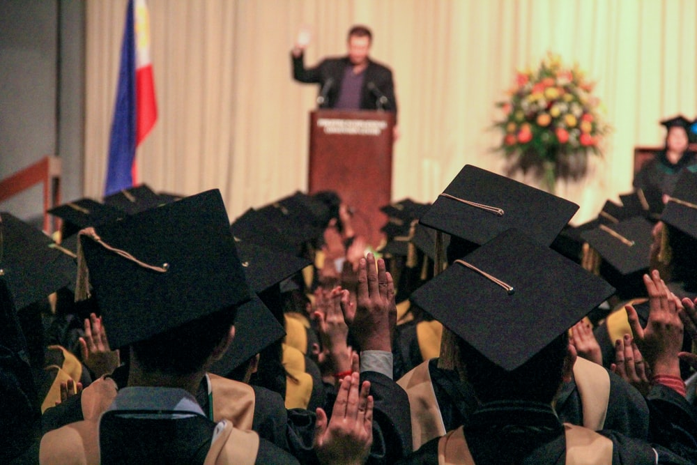 man delivering speech on graduation