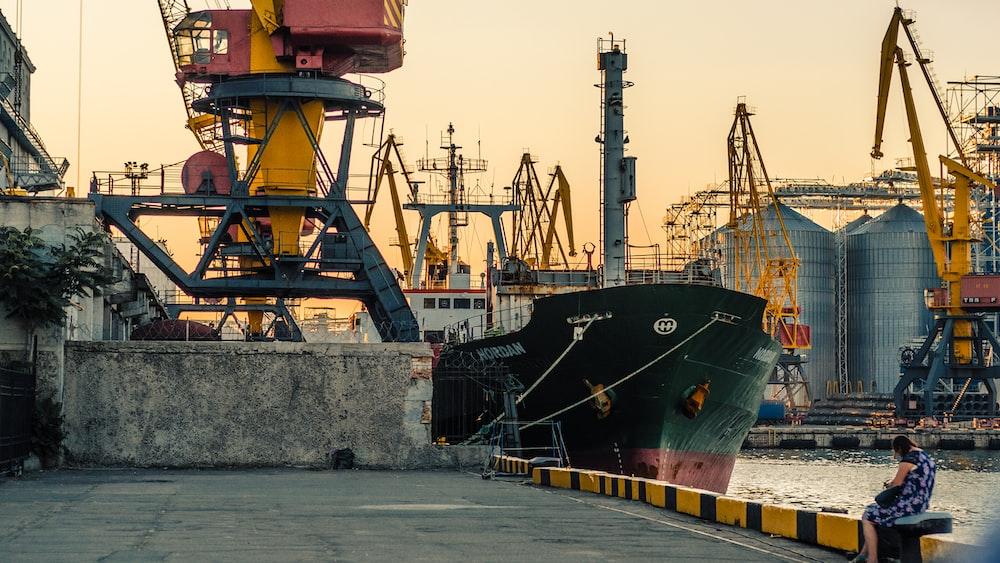 black cargo ship beside dock