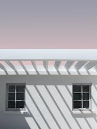closeup photo of white concrete house