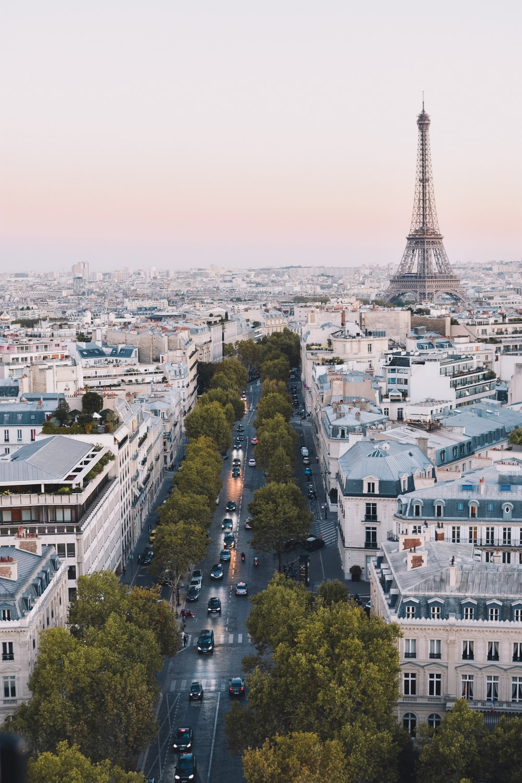 busy street near Eiffel Tower in Paris during daytime