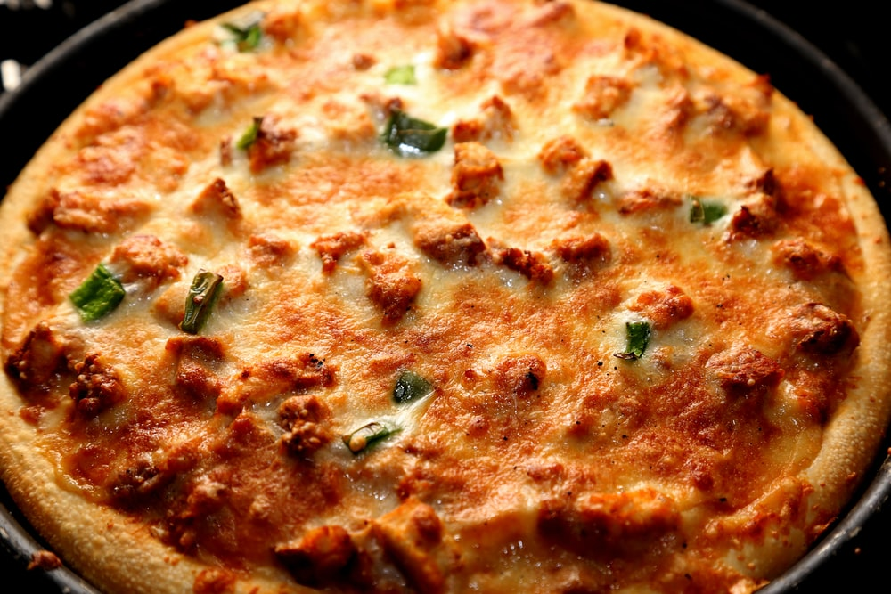 pizza with spices and cheese