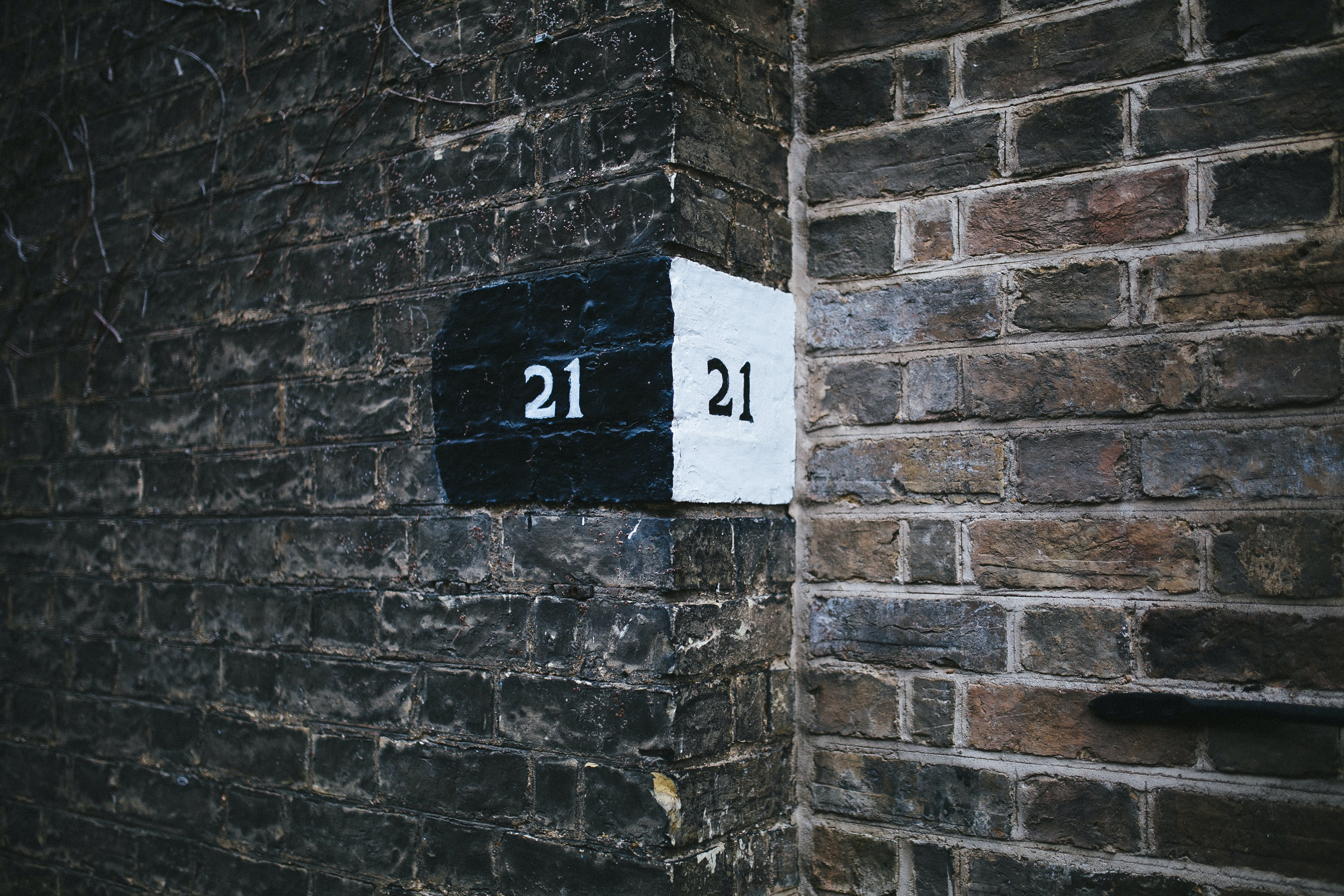 brown brick wall showing numbers
