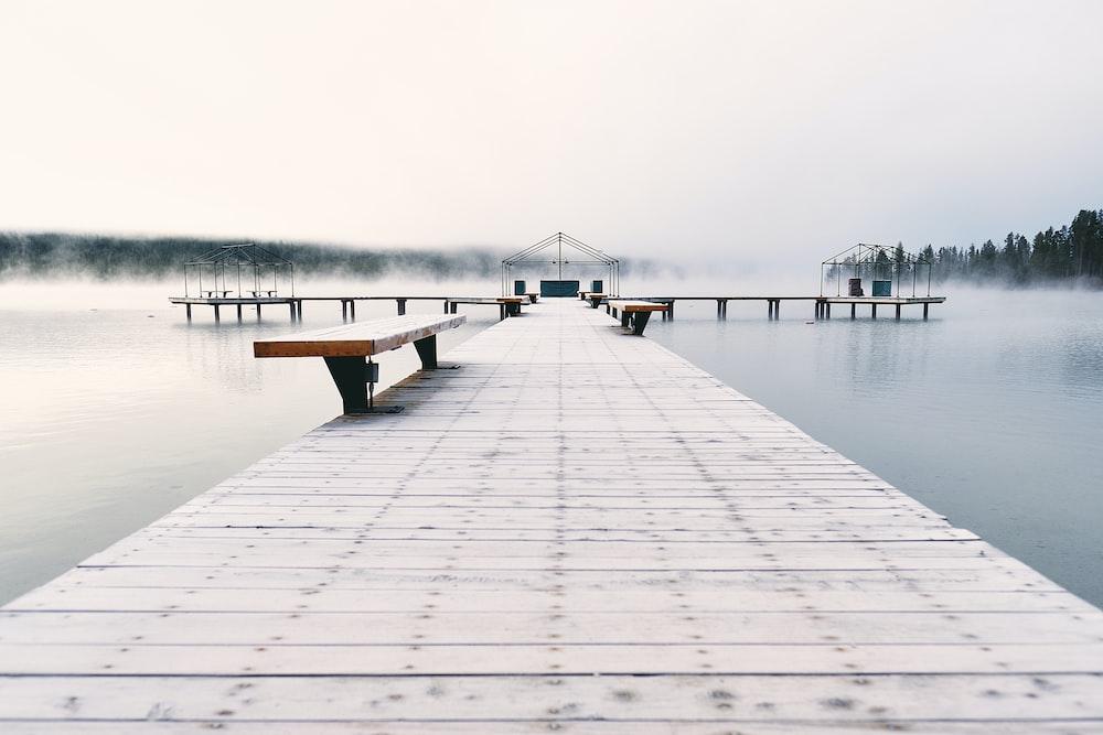 brown bench on brown wooden bridge