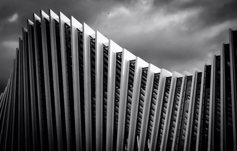 greyscale photography of spiral building