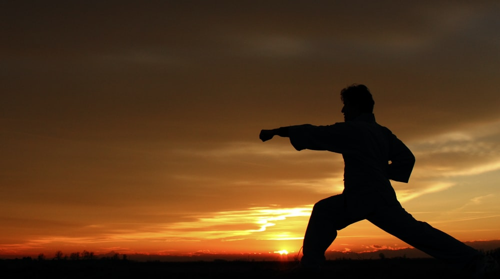 silhouette photography of man punching on air