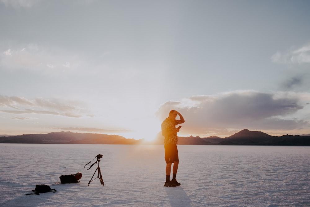 man standing on ice field