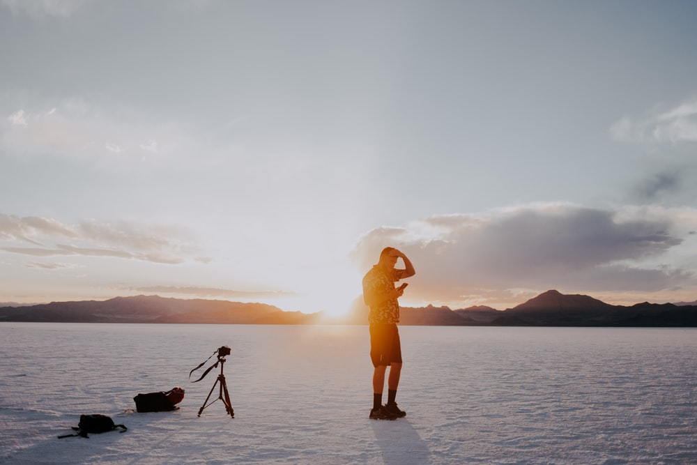 man standing on ice field