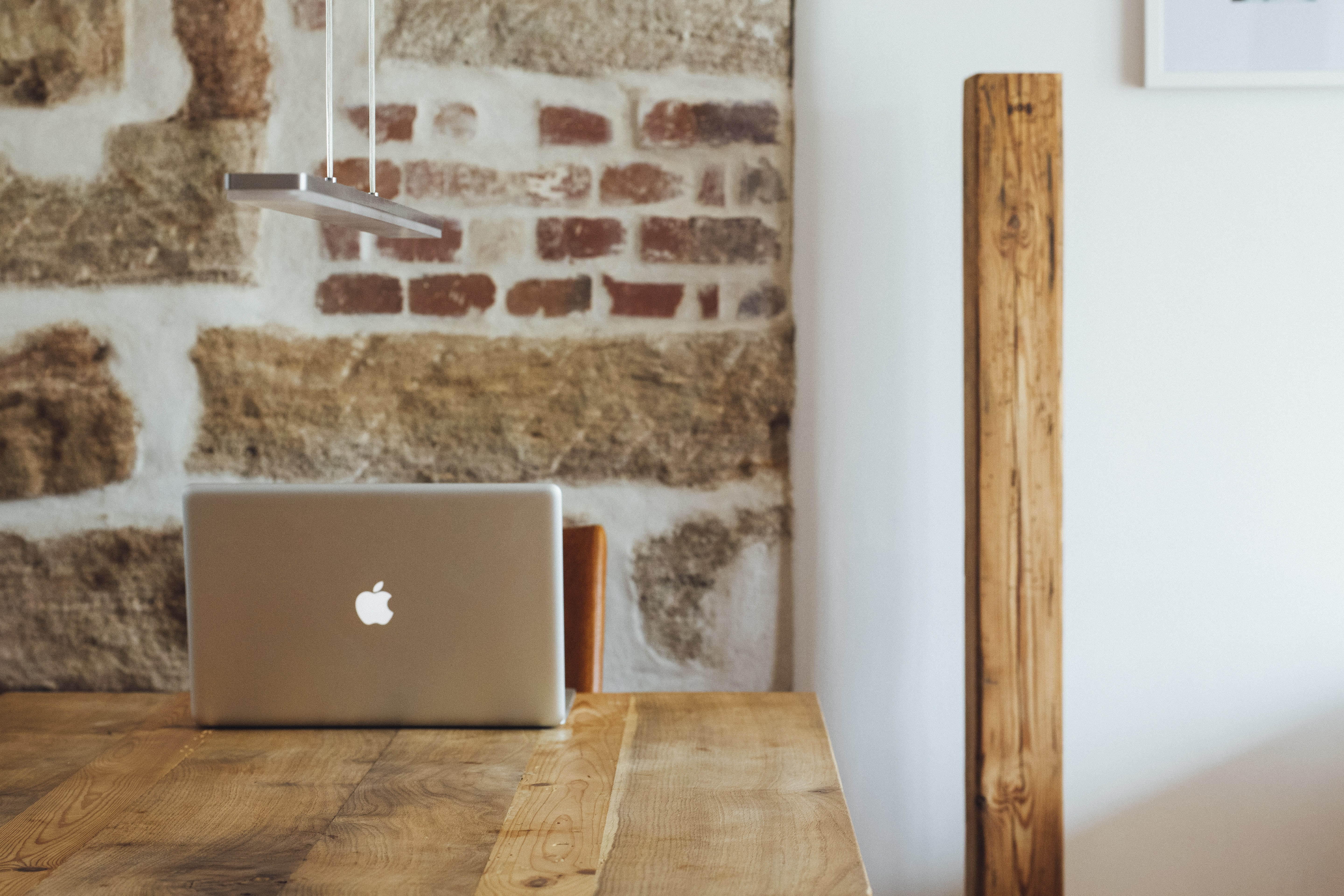 minimalist photography of silver MacBook placed on top of wooden table