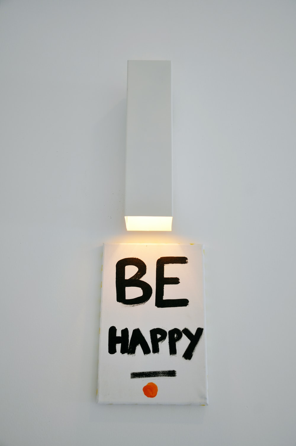 be happy sign on white surface