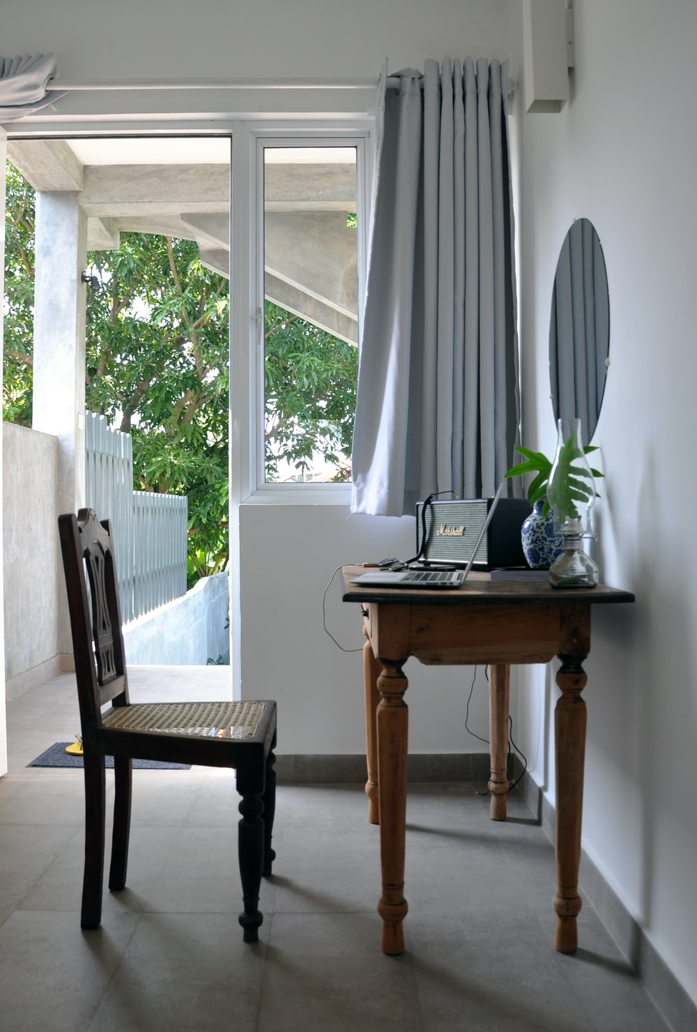 black chair in front of console table