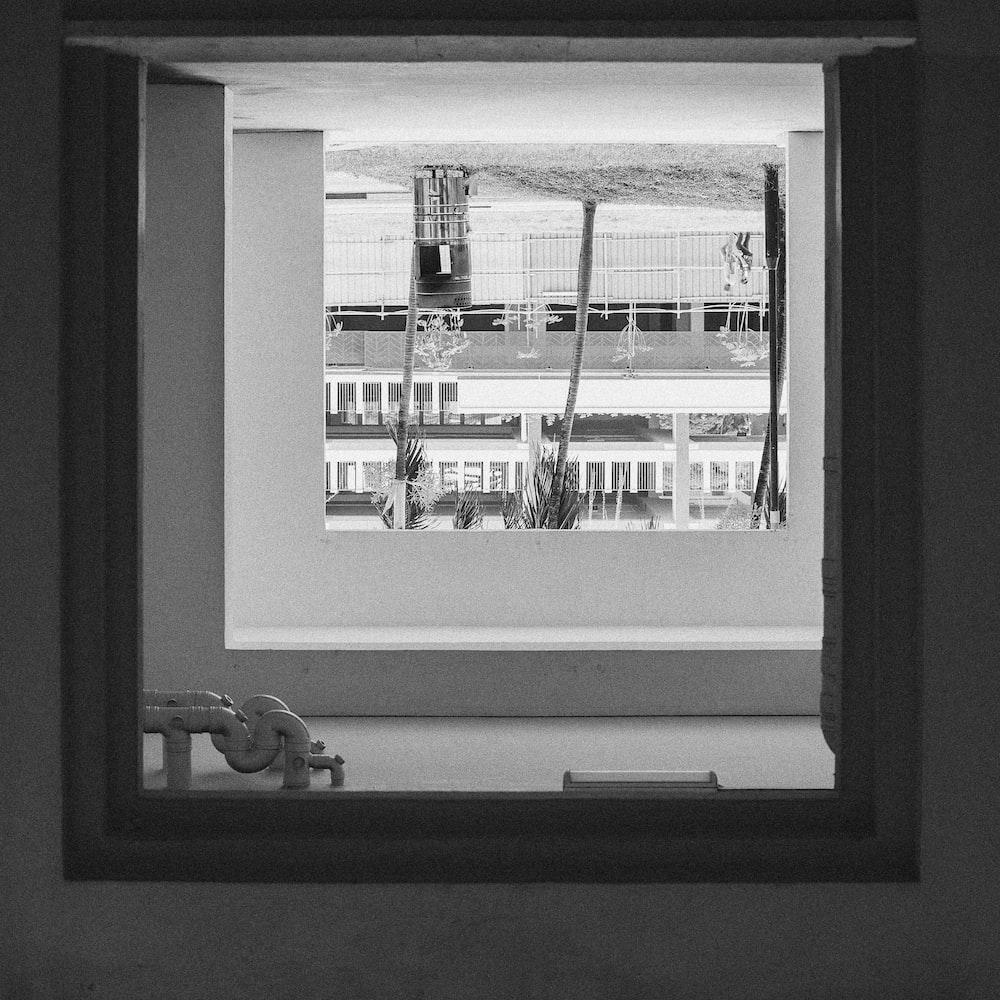 grayscale photography of window