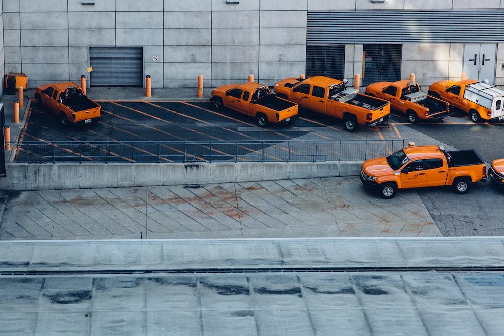 orange pickup trucks on parking lot