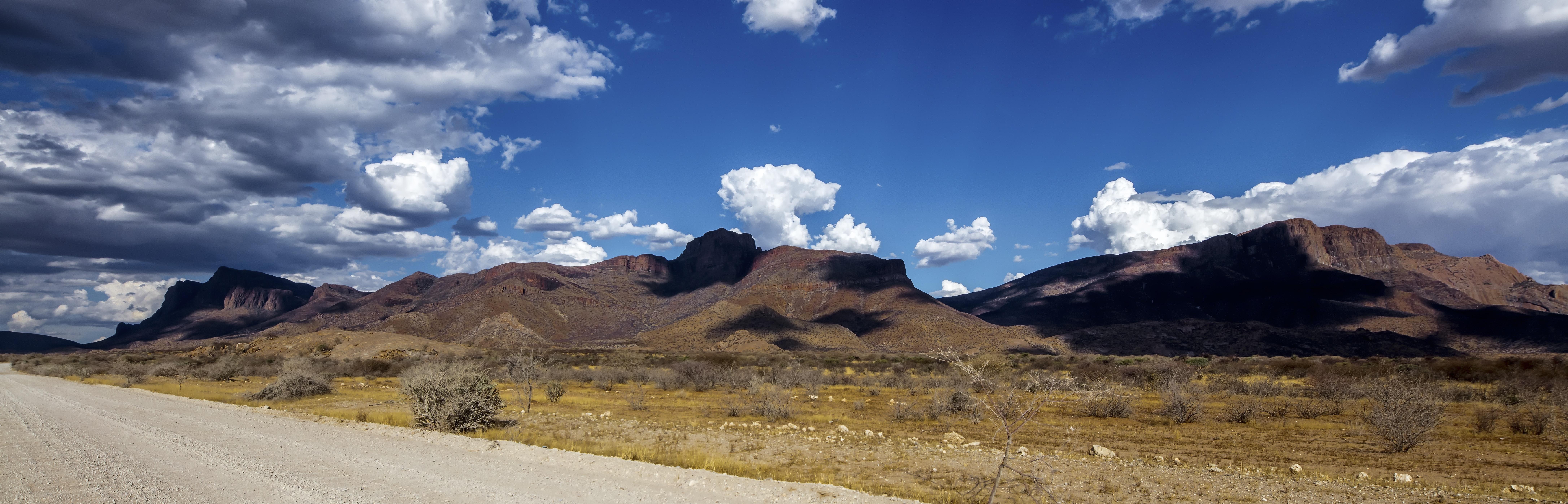 photo of roadway near hills