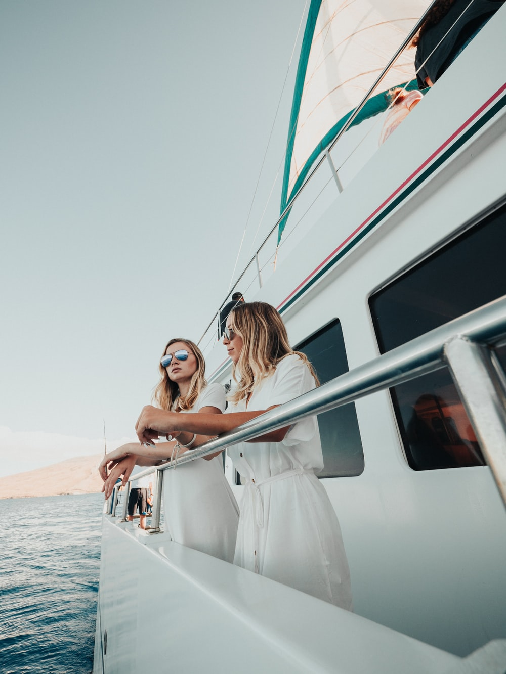 two women standing on yacht during daytime