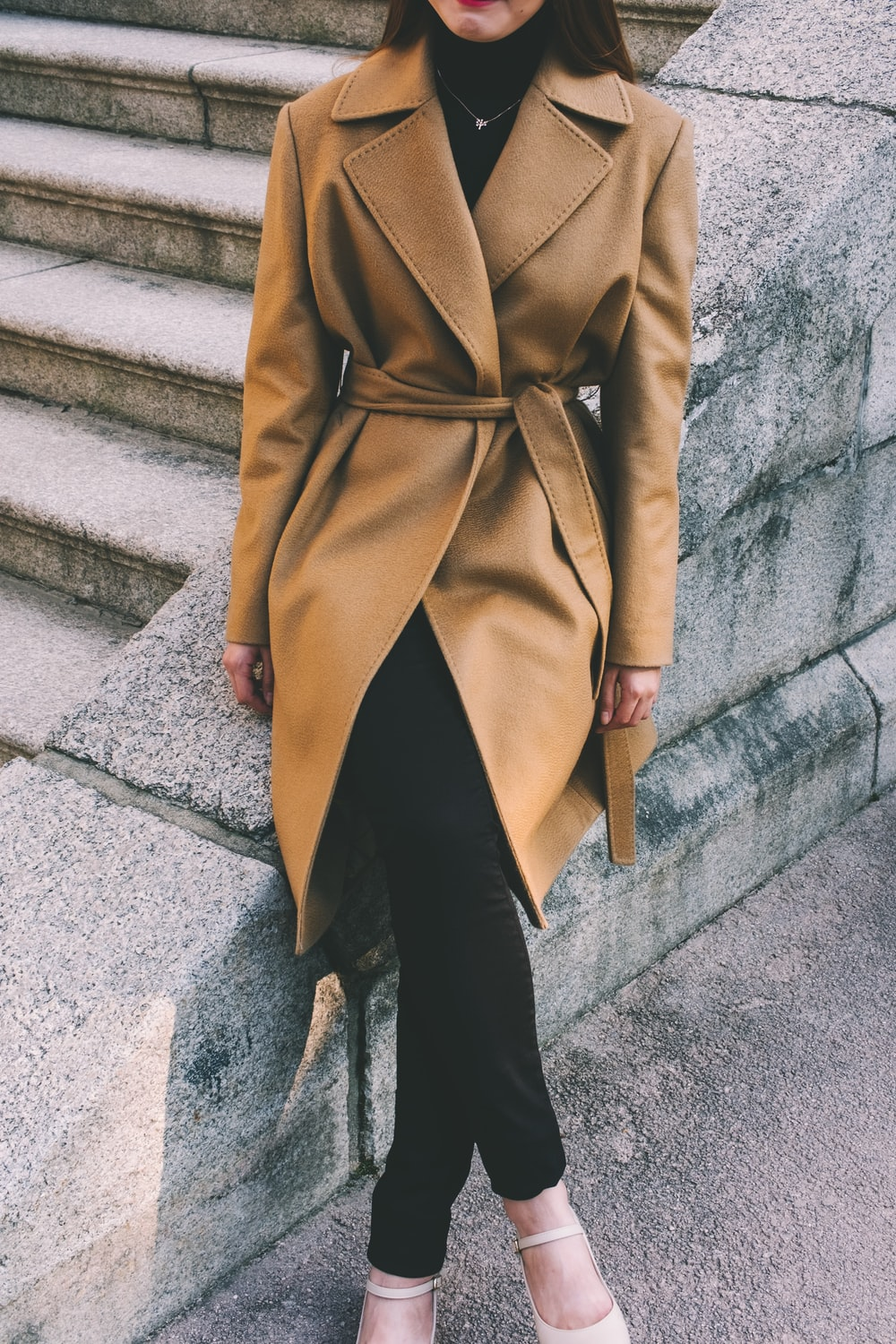 woman wearing brown notched lapel coat