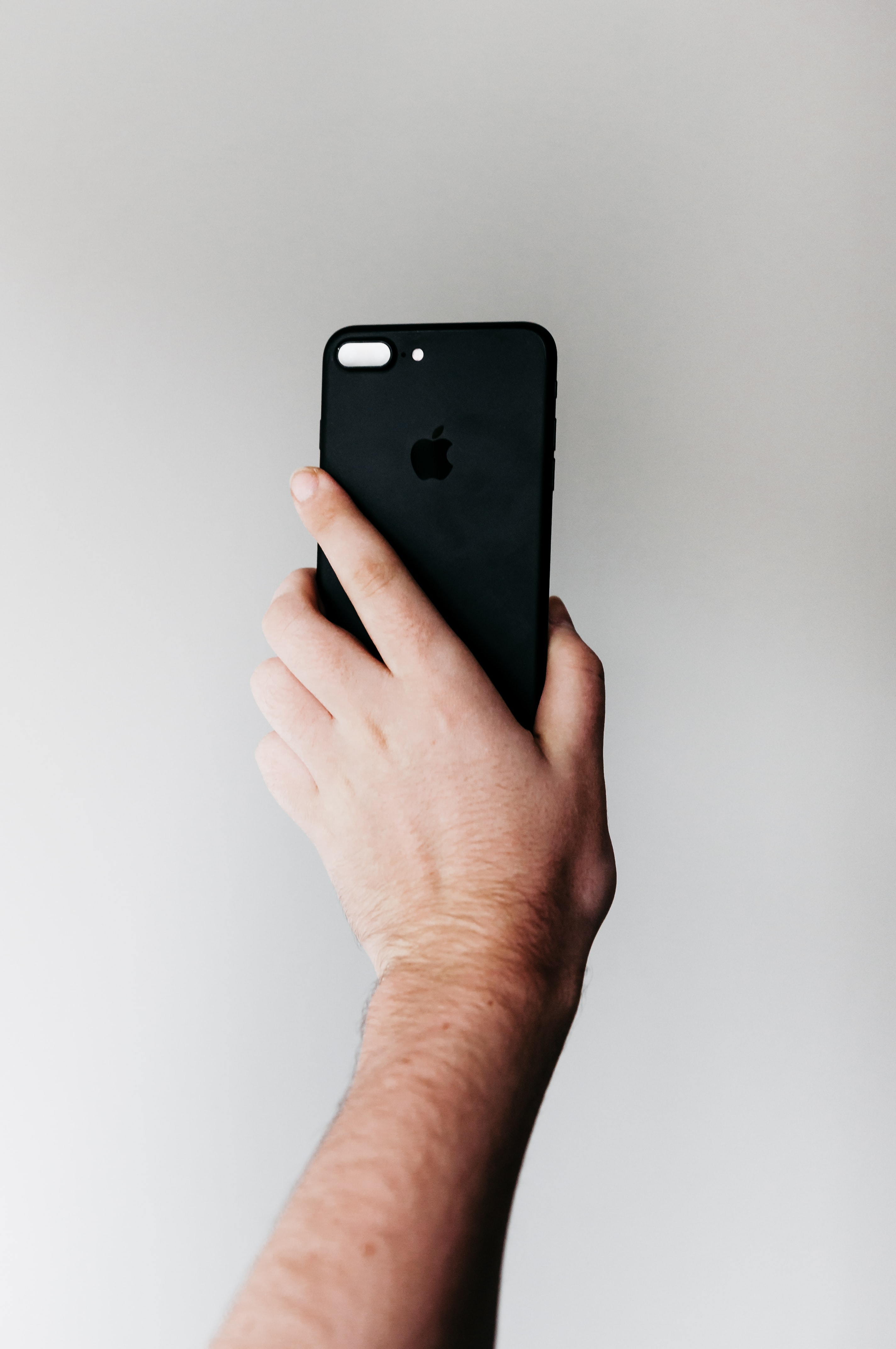 person holding space gray iPhone 8 Plus