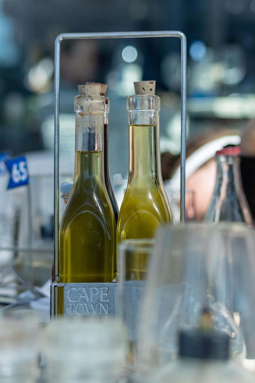 selective focus photography of oil inside glass cork bottles